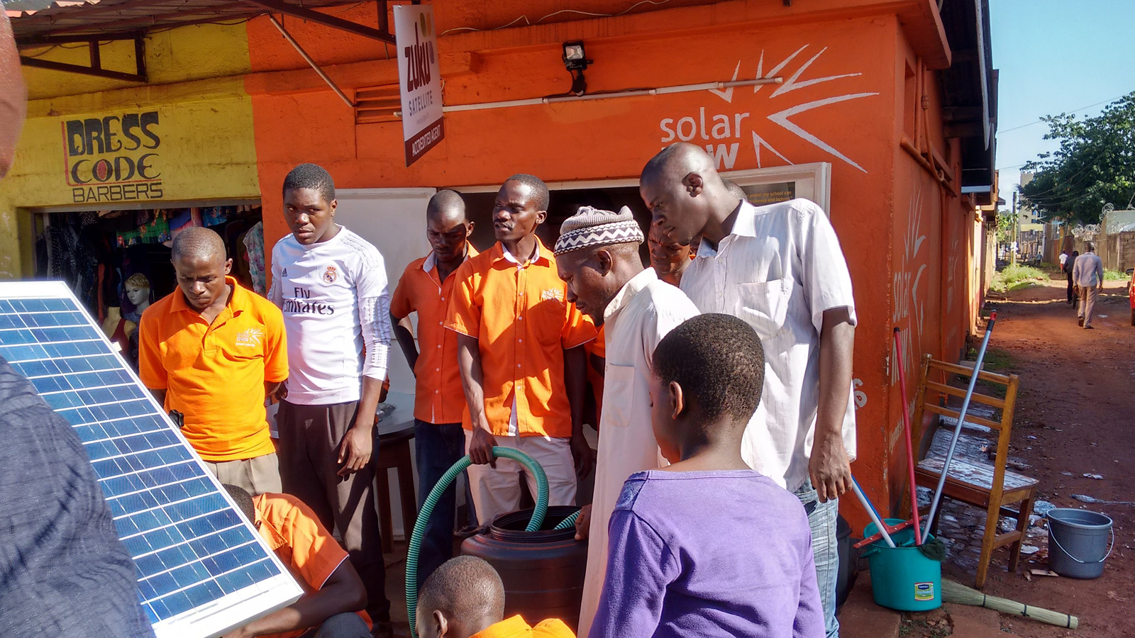 A demonstration of the solar pump outside a SolarNow store in Uganda