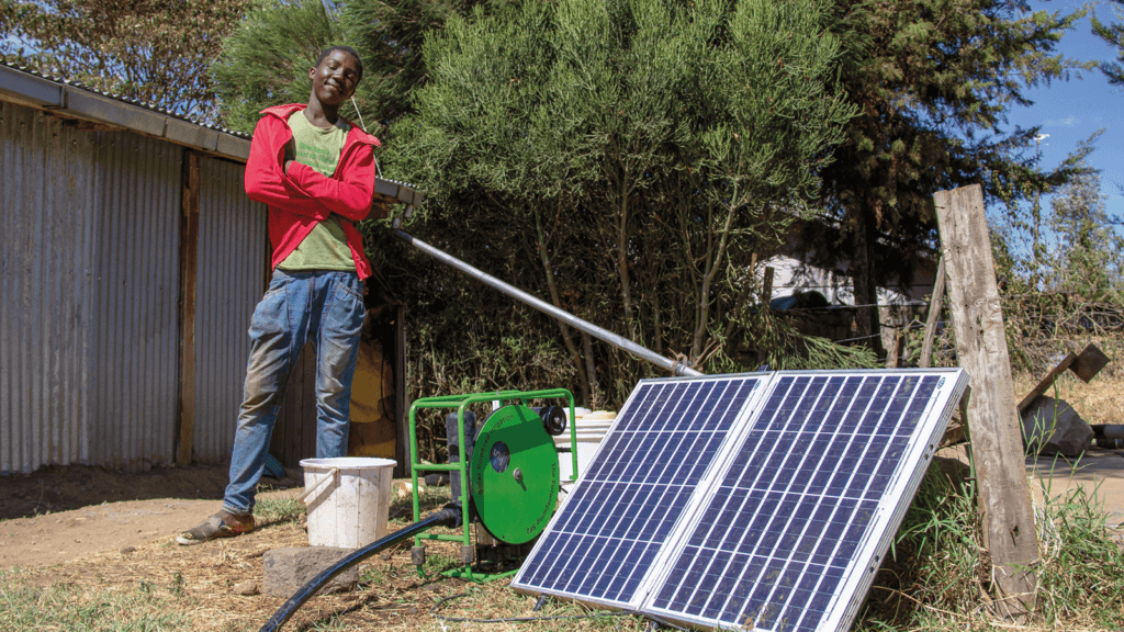Happy farm hand with SF2 solar water pump